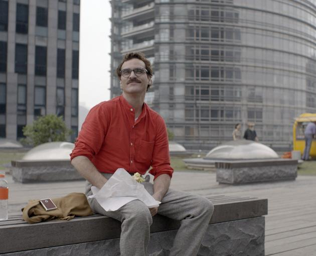 Joaquin Phoenix in the film Her, in which he begins a relationship with an AI system. Photo:...