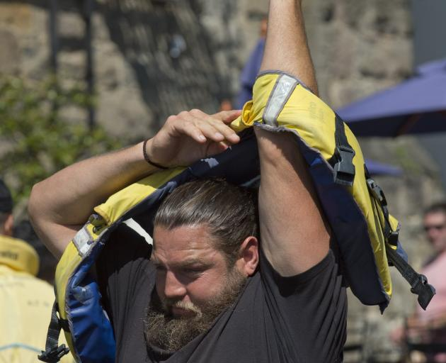 Otago prop Josh Hohneck puts a life jacket on before heading out on to the water yesterday.