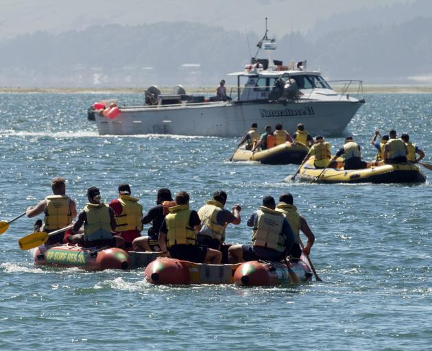 Members of the Highlanders meet some other boats on Otago Harbour yesterday. PHOTOS: GERARD O'BRIEN