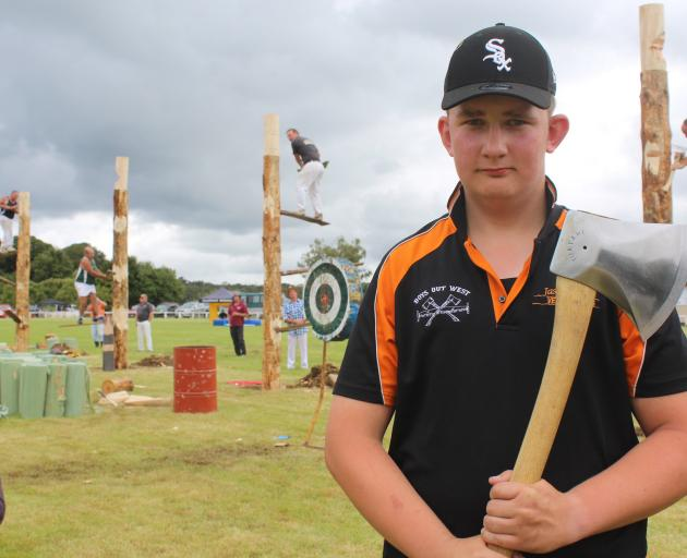 Eastern Bush resident Jack Richards takes part in the wood-chopping competition at the Tuatapere Sports Day in Southland yesterday. PHOTO: ABBEY PALMER