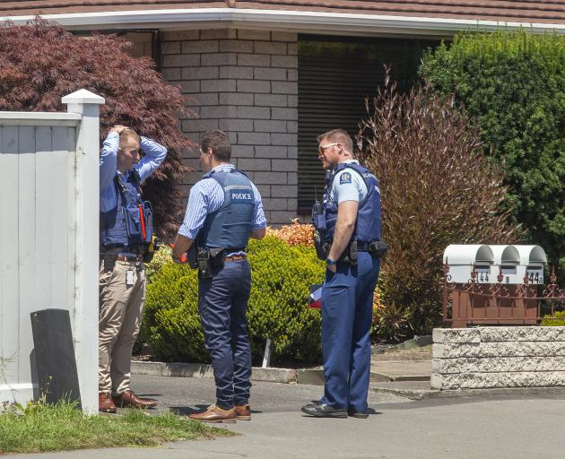 Police at the property in Papanui where the body has been found. Photo: Geoff Sloan