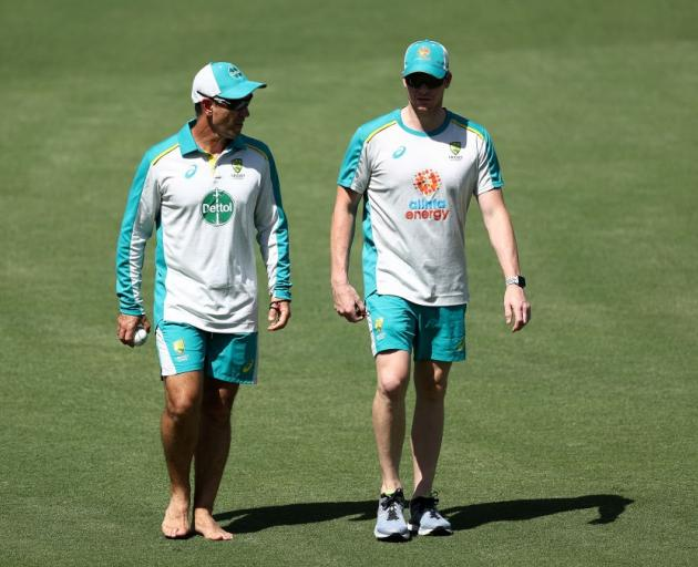 Justin Langer and Steve Smith talk during an Australian training session. Photo: Getty Images