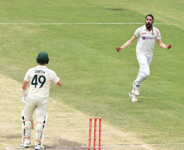Mohammed Siraj celebrates the wicket of Steve Smith at the Gabba yesterday during the fourth test...