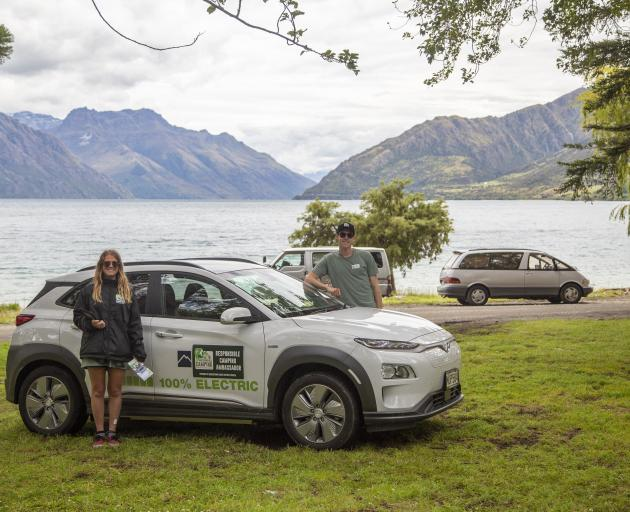 Queenstown Lakes freedom camping ambassadors Sophie Johnston and Neco Wieringa check a lakeside...
