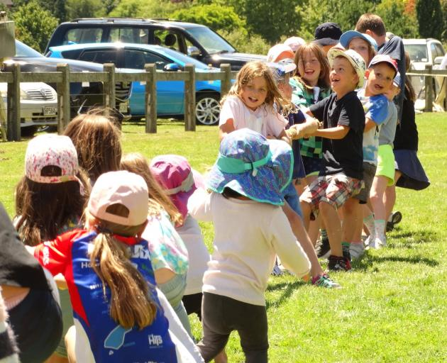 The effort goes in during the children's tug-of-war at the Lake Hayes A&P Show near Queenstown on...