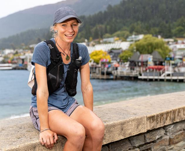 Brooke Thomas, of Queenstown, takes a breather in the resort yesterday morning on her run from...