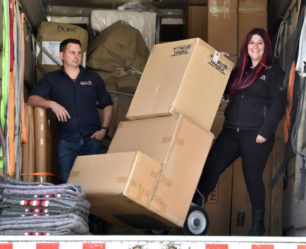 Southern Furniture Movers owner and managing director Teressa Grigg and general manager Simon...