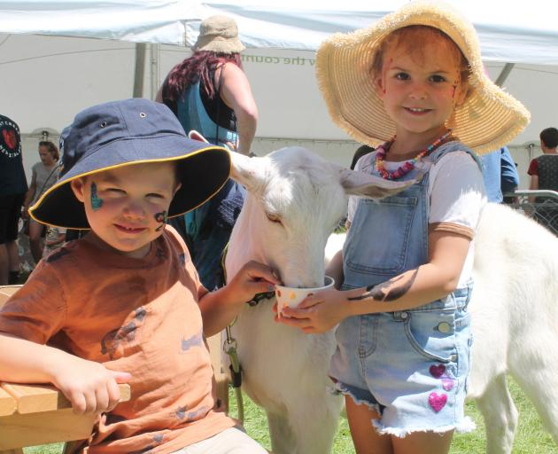 Hudson Forde (4) and Madison Palmer (3) feed pet goat Paxton.