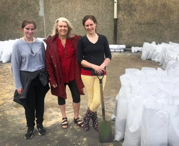 Sandbagging in South Dunedin during the flood alert are (from left) Larissa McStay, Ingrid Leary...