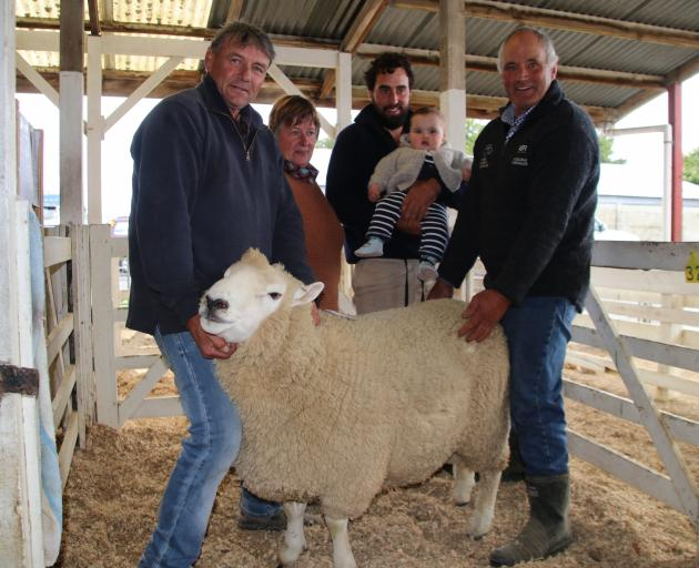 Moa Flat farmer Lloyd Brenssell holds the head of the Perendale ram he paid $9500 for at the...