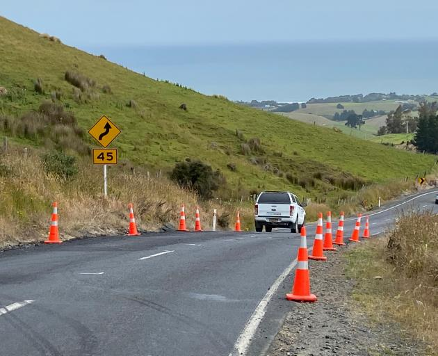 A vehicle negotiates the short stretch of Scroggs Hill Rd, between Allanton-Scroggs Hill Rd and...