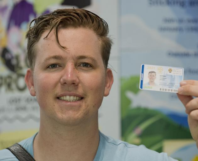 University of Otago Summer School student Thomas Jensen is issued with his ID card as the latest...