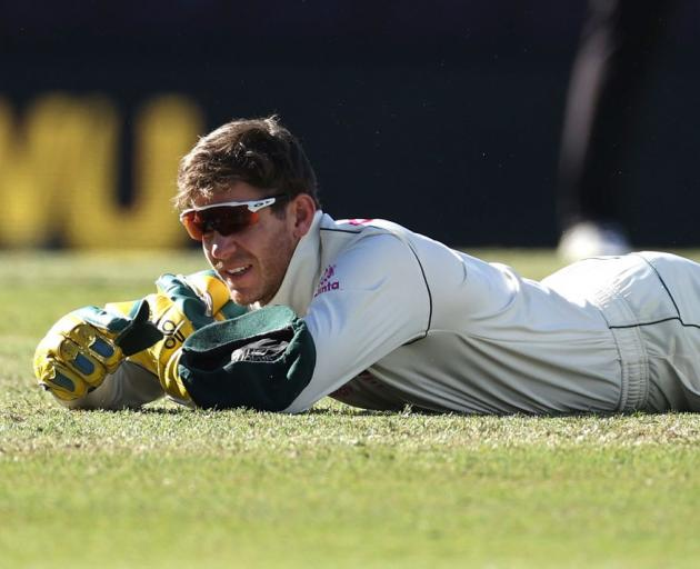 Tim Paine reacts after dropping a catch during Australia's draw with India at the Sydney Cricket...