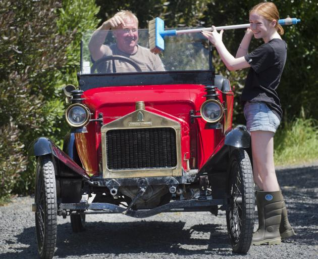 Emma Boult (15) gives her father Phill's 1913 Alldays and Onions car a clean, in preparation for...