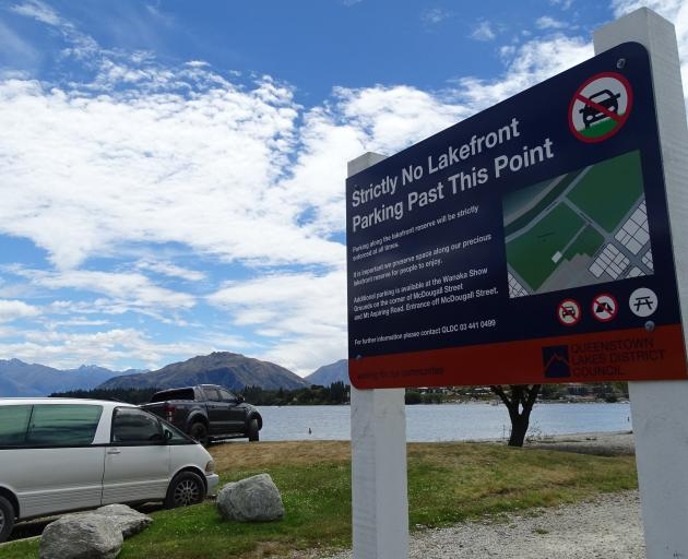 Every year on New Year's Eve drivers ignore signs not to park on the grass on the Lake Wanaka...
