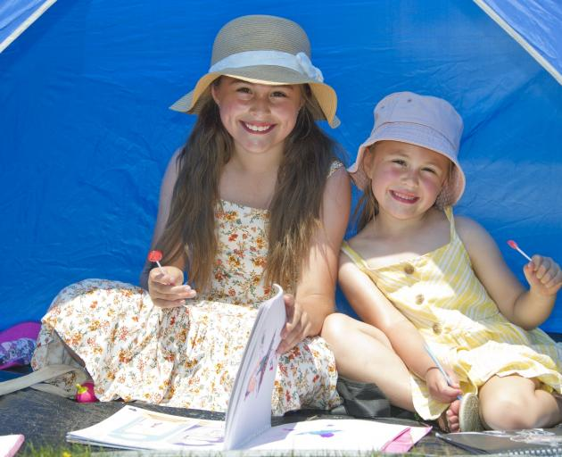 Ava (9) and Keira Goodman (5), of Dunedin, made the most of some shade at the Waikouaiti Racing...