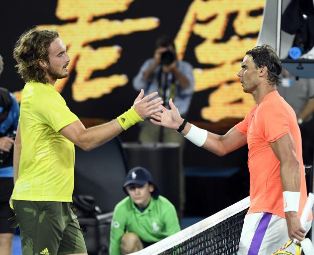 Stefanos Tsitsipas shakes hands with Rafael Nadal. Photo: Reuters
