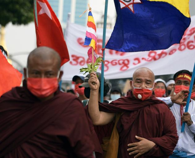 Buddhist monks take part in a protest against the military coup in Yangon on Monday. Photo: Reuters