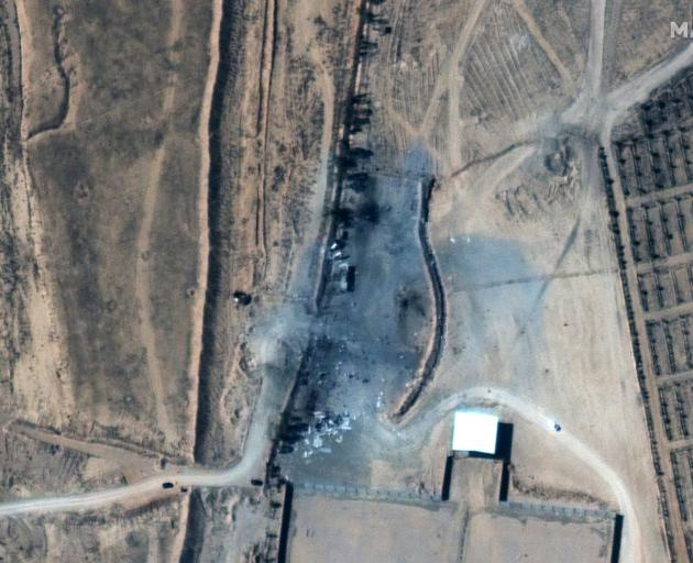 A close up view of destroyed buildings at an Iraq-Syria border crossing after airstrikes. Photo:...