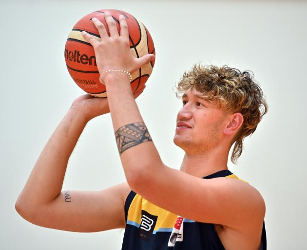 Otago Nuggets signing Akiva McBirney-Griffin gets in some practice at the Edgar Centre yesterday....