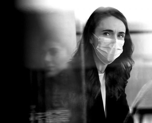 New Zealand Prime Minister Jacinda Ardern wears a mask during a visit to Crave Cafe on August 31,...