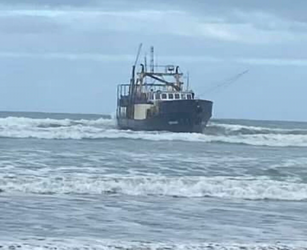 The boat has beached on Big Bay. Photo: Supplied via NZH