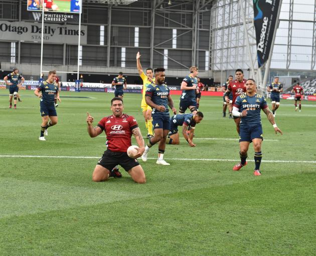 Crusaders hooker Cody Taylor celebrates an early try against the Highlanders. PHOTO: GREGOR...