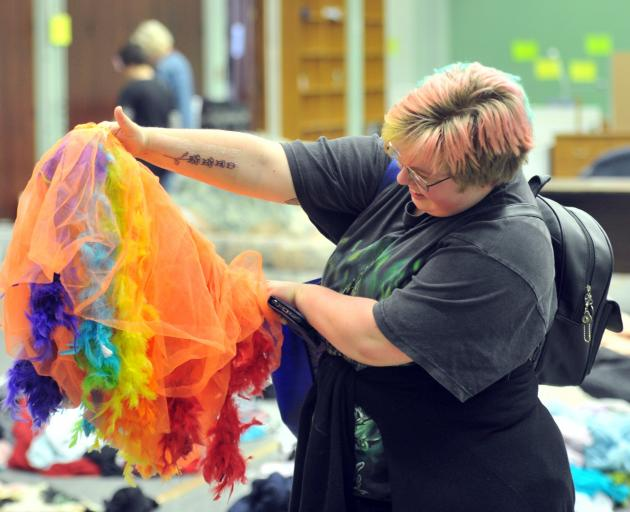 Communication and psychology student Theodora Morris (21) checks out a tutu at the University of...