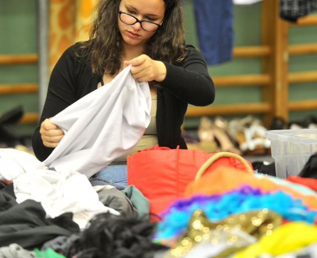 Carrington College resident Alex Hewitt (17) hunts for a bargain at the University of Otago O...