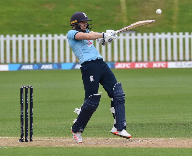 Heather Knight hits out for England during its innings. The White Ferns won by seven wickets...