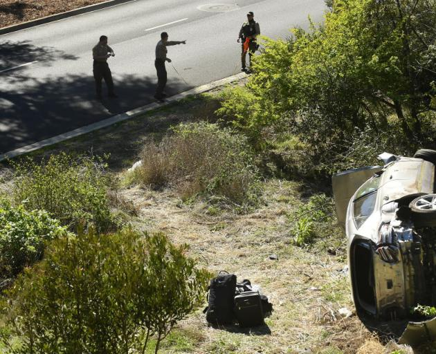 L.A. County Sheriff's officers investigate an accident involving famous golfer Tiger Woods. Photo...