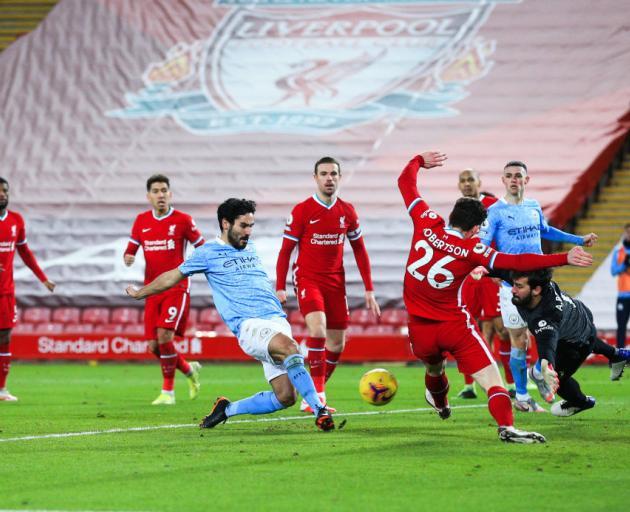 Ilkay Gundogan scores Manchester City's first goal during the Premier League match against...