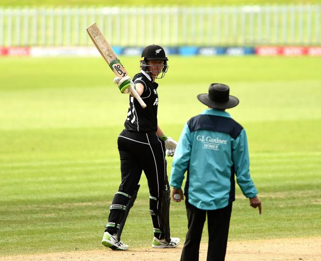 Amy Satterthwaite celebrates her hundred. Photo: Getty Images