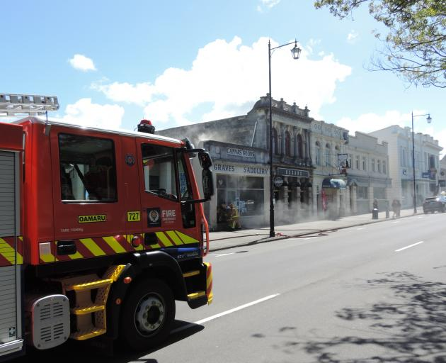 Fire crews at the scene of a fire at the historic Grave's Saddlery in Oamaru. Photo: Ashley Smyth