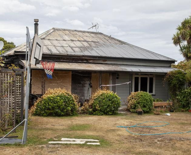 The Kirwee cottage was extensively damaged in a fire on Waitangi Day. Photo: Geoff Sloan