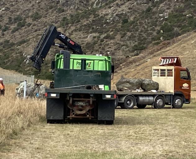 Contractors removing three rocks from Barnett Park. Photo: Amanda Rudkin