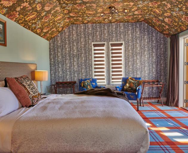 The rooms at boutique Queenstown hotel The Dairy are decked out  with quirky wallpaper and...