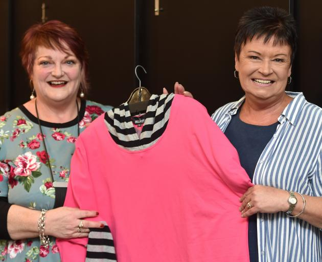 Owner Diane McKenzie (left) and retail manager Gayle McCormick prepare for the impending opening...