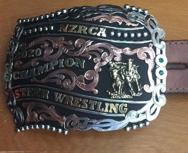 A buckle and saddle (below) were awarded to Greg Lamb for winning the 2020 national steer...