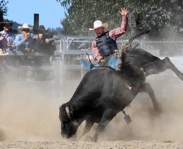 Mervin Church jnr, of Rotorua, rides in the open bull event.