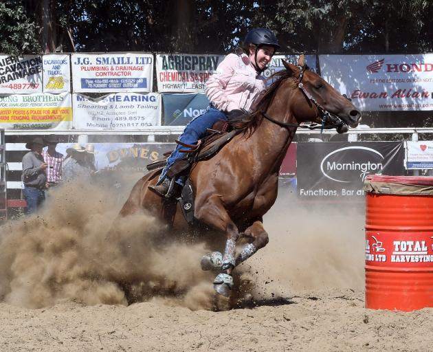 Nancy Franco, of Kaiapoi, competes in the open barrel race.