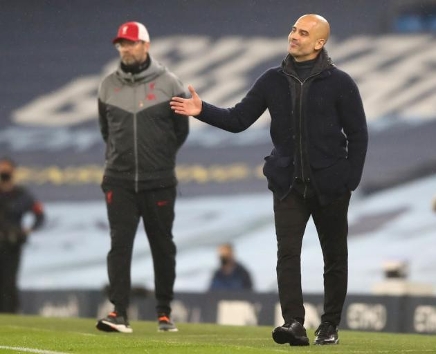 Jurgen Klopp (left) and Pep Guardiola during the last game between Liverpool and Manchester City....