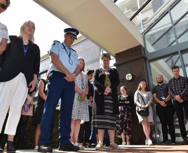 Dunedin police and staff pause at the Dunedin Central Police Station in memory of the...