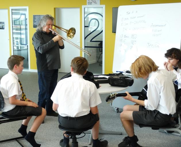 Jamming with jazz trombonist Rodger Fox, of Wellington, are Wakatipu High School pupils (from...