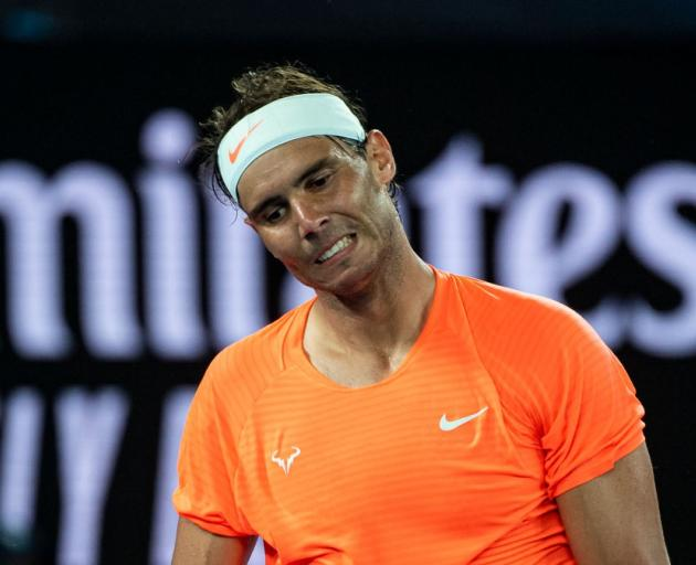 Rafael Nadal looks frustrated during his quarterfinal loss at the Australian Open last night....