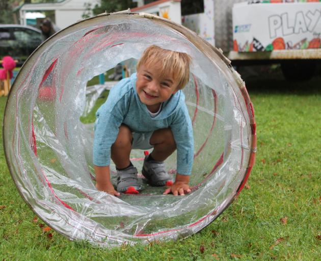 Flynn Froger (3) has a blast during the event to celebrate the reopening of the Feldwick Gates.
