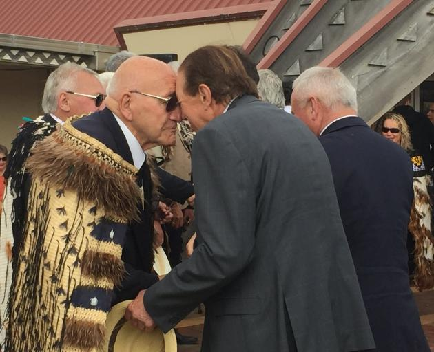 Sir Tipene O'Regan performs a hongi with Invercargill Mayor Sir Tim Shadbolt at the Waitangi Day...