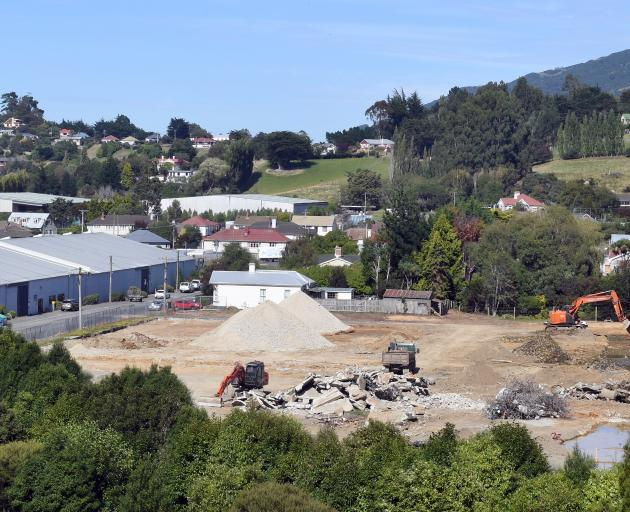Diggers clear the site for a new warehouse for Hilton Haulage at Sawyers Bay yesterday. PHOTO:...
