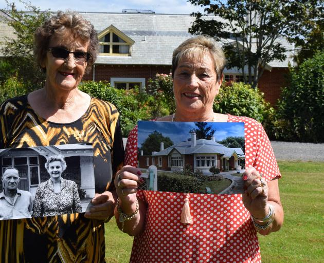 Patricia Snell and Joan King hold  photos of their parents Percy and Rita Birley, who managed  ...