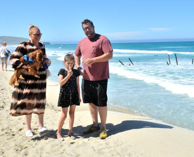 Enjoying a day at St Clair Beach are Jemma and Andrew Wills, of Dunedin, with their daughter...